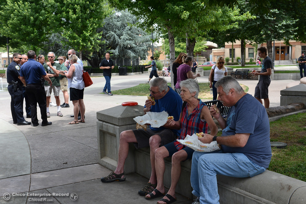 . Teri DuBose, owner of Broadway Pawn, invites local residents to eat lunch with her every Wednesday in City Plaza to help encourage acceptable public use of the park. People gather for lunch Wendesday, June 7, 2017, in City Plaza in Chico, California. (Dan Reidel -- Enterprise-Record)