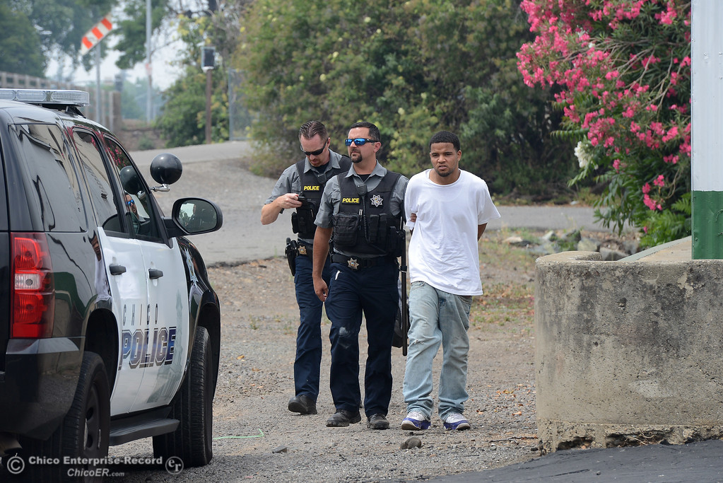 . Chico police take a man into custody at The Esplanade and West 11th Avenue as officers investigate a shooting Wednesday, June 7, 2017, that began at Cohasset and the Esplanade and involved chases in several directions in Chico, California. (Dan Reidel -- Enterprise-Record)