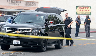 Chico Police Officers search for a gunman after reports of a shooting near Cohasset Road in Chico, Calif. Wed. June 7, 2017. (Bill Husa -- Enterprise-Record)