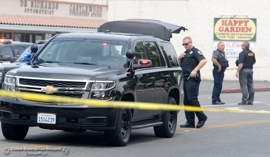 . Chico Police Officers search for a gunman after reports of a shooting near Cohasset Road in Chico, Calif. Wed. June 7, 2017. (Bill Husa -- Enterprise-Record)
