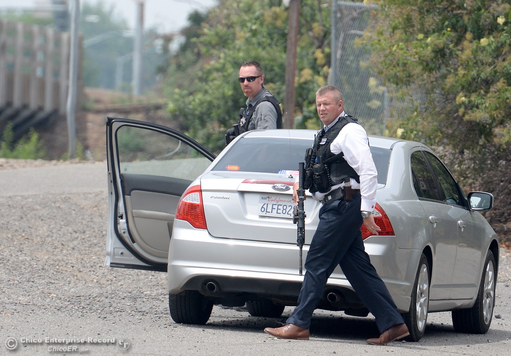 . Chico Police and Butte County Sheriff\'s Deputies search for a gunman after reports of a shooting near Cohasset Road in Chico, Calif. Wed. June 7, 2017. (Bill Husa -- Enterprise-Record)