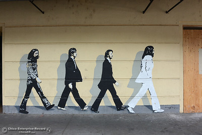"The Beatles mural by Gregg Payne from the photo by Iain Macmillan on their album ""Abbey Road"" has adorned the concrete wall at 135 Main Street in Chico, California, for more than 20 years. The mural remains intact Wednesday, June 8, 2016, but a new business at the location could mean the mural will be repainted on another part of the building. (Dan Reidel -- Enterprise-Record)"