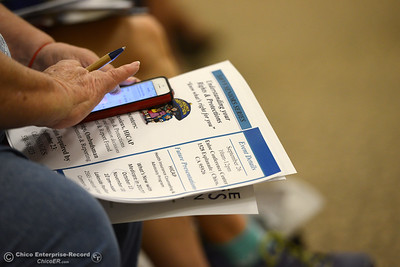 "An attendee looks over literature before Connie Massie, licensed clinical social worker, gives a presentation titled ""Coping with Emotional Transitions of Aging"" Thursday, June 9, 2016, at Enloe Conference Center in Chico, California. (Dan Reidel -- Enterprise-Record)"