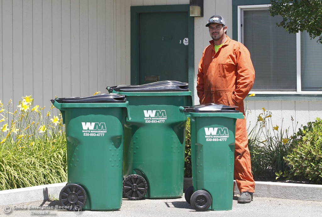 . Waste Management container technician Buddy Swanson stands next to the three sizes of waste bins they offer Monday June 12, 2017 at Waste Management in Chico, California. (Emily Bertolino -- Enterprise-Record)