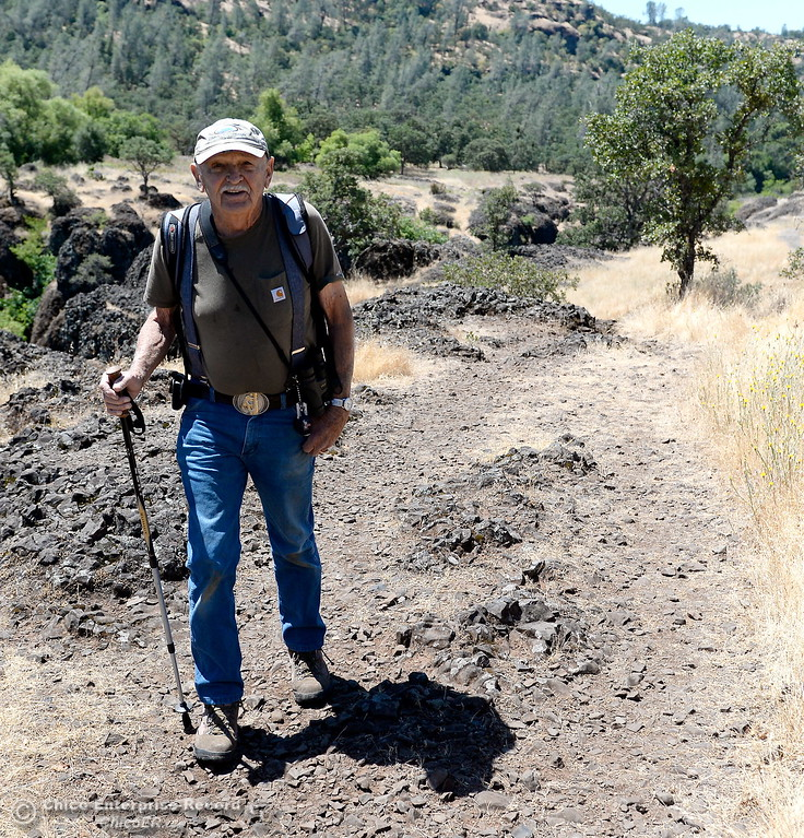 """. Don Walther of Chico is seen along the Yahi Trail between the Diversion Dam and Salmon Hole in Upper Bidwell Park in Chico, Calif. Tues. June 13, 2017. Don said he had been hiking the area since 1939 and added that \""""It\'ll keep you in shape!\""""   The idea of a linked, non-motorized trail system in California has been discussed for years, but the idea gained momentum last month during a firety-ever conference held in Chico.(Bill Husa -- Enterprise-Record)"""