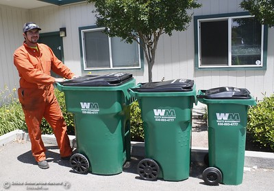 Waste Management container technician Buddy Swanson stands next to 96, 64 and 32 gallon waste bins Monday June 12, 2017 at Waste Management in Chico, California. (Emily Bertolino -- Enterprise-Record)