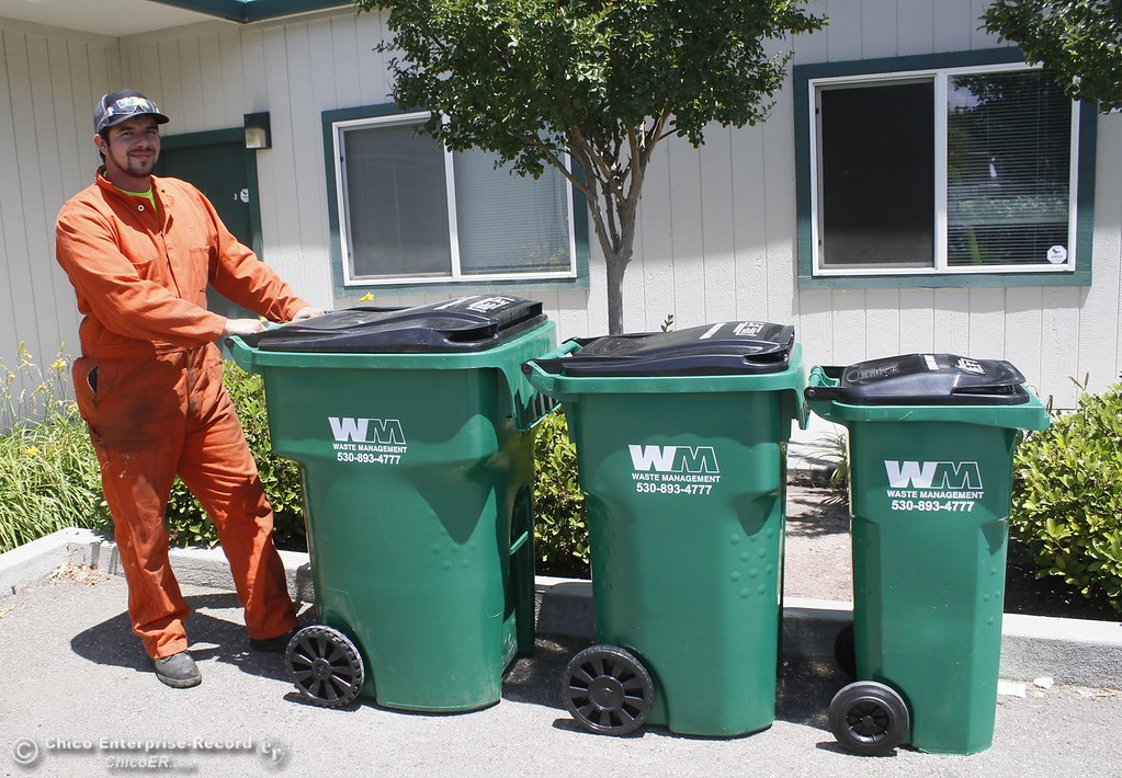 . Waste Management container technician Buddy Swanson stands next to 96, 64 and 32 gallon waste bins Monday June 12, 2017 at Waste Management in Chico, California. (Emily Bertolino -- Enterprise-Record)