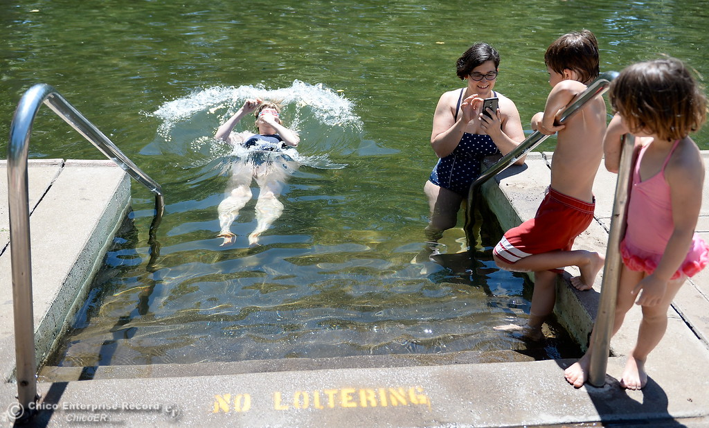 . Shayna McConville of Ohio takes the plunge along with friends Mira Watkins and her children Ruby Watkins 4 and Willie Watkins 8 as they cool off in Sycamore Pool at the One Mile Recreation Area of Bidwell Park as temperatures rise in Chico, Calif. Wed. June 14, 2017. (Bill Husa -- Enterprise-Record)