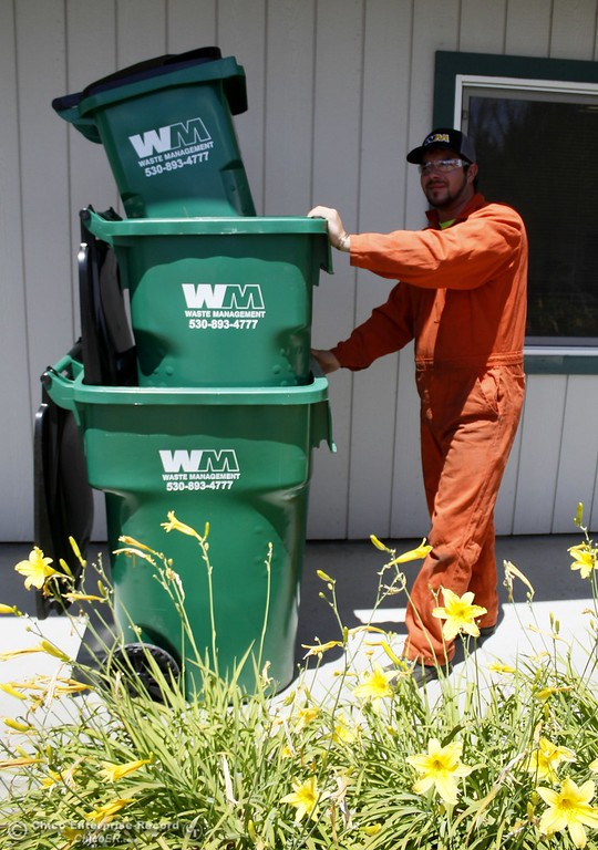 . Waste Management container technician Buddy Swanson wheels out three sizes of waste bins Monday June 12, 2017 at Waste Management in Chico, California. (Emily Bertolino -- Enterprise-Record)