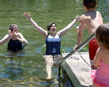 Shayna McConville of Ohio at left watches as Mom Mira Watkins of Chico takes the plunge while her children Ruby Watkins 4 and Willie Watkins 8 watch them cool off in Sycamore Pool at the One Mile Recreation Area of Bidwell Park as temperatures rise in Chico, Calif. Wed. June 14, 2017. (Bill Husa -- Enterprise-Record)