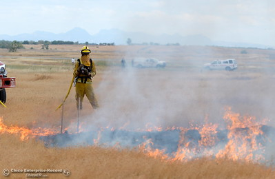 CAL FIRE/Butte County Fire Department lite controlled burns near the Oroville Airport Monday June 12, 2017. The live burns are training for new firefighters and help firefighters study fire behavior in a controlled environment. (Bill Husa -- Enterprise-Record)
