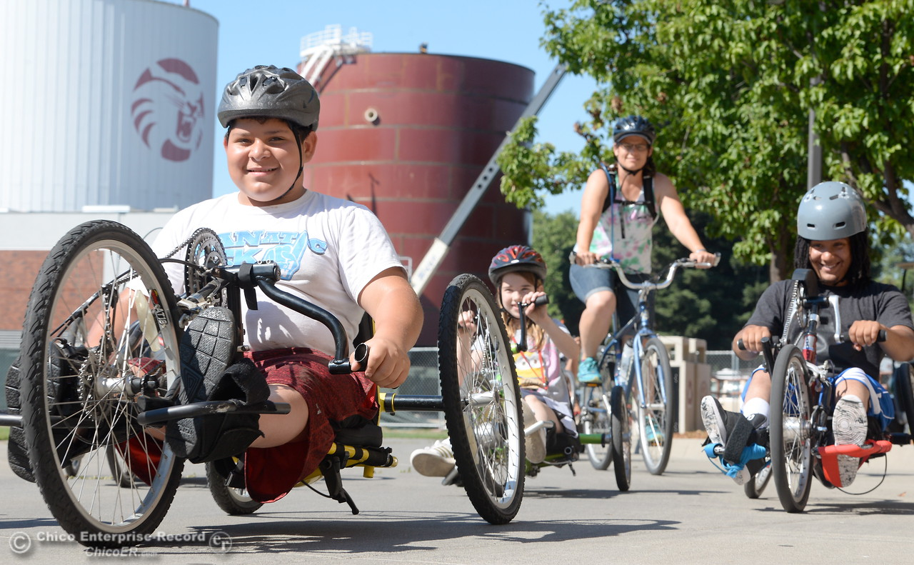 Isias Chavez left and Trevor Ford at right take off on hand cycles during the Ability First Camp for kids with disabilities at CSUC Tuesday June 20, 2017. (Bill Husa -- Enterprise-Record)