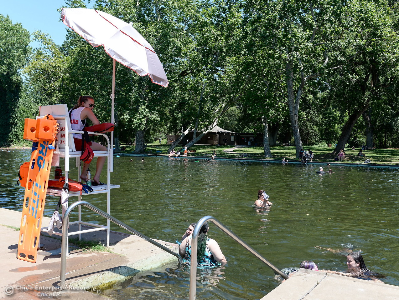 A Lifeguard keeps watch as people cool off in Sycamore Pool at the One Mile Recreation Area in Bidwell Park Tuesday June 20, 2017. (Bill Husa -- Enterprise-Record)