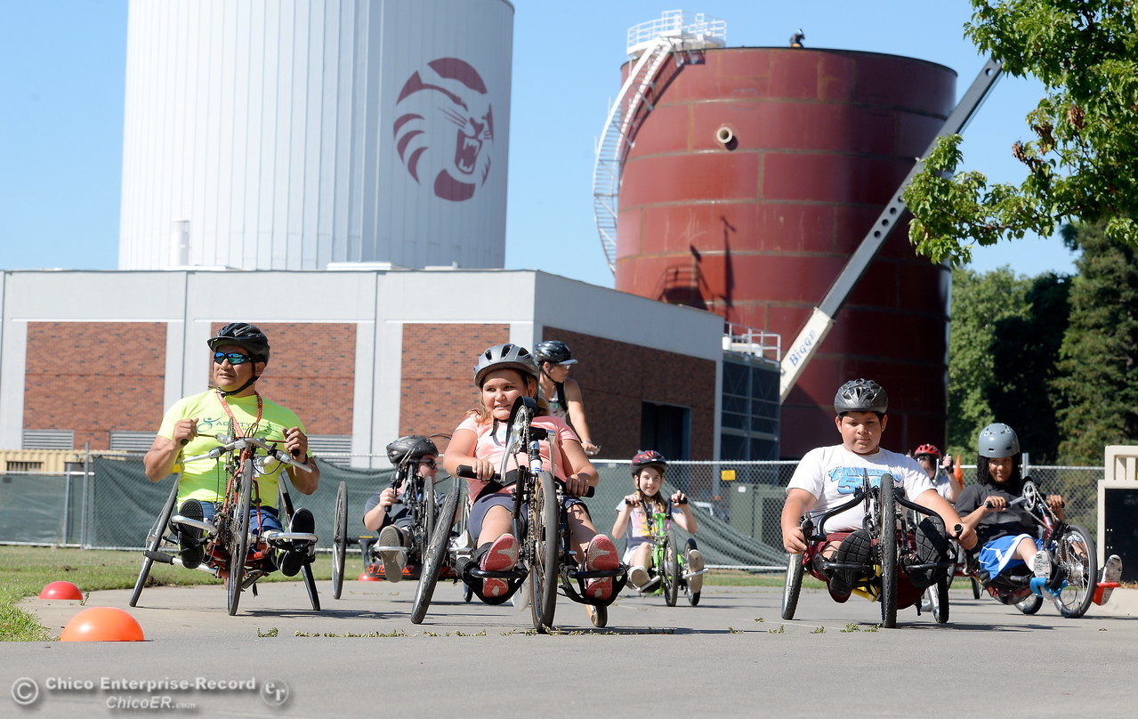 A group of riders along with their coaches take off on hand cycles during the Ability First Camp for kids with disabilities at CSUC Tuesday June 20, 2017. (Bill Husa -- Enterprise-Record)