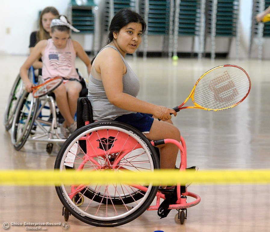 . Lourdes Mack of Santa Monica plays some tennis during the Ability First Camp for kids with disabilities at CSUC Tuesday June 20, 2017. (Bill Husa -- Enterprise-Record)