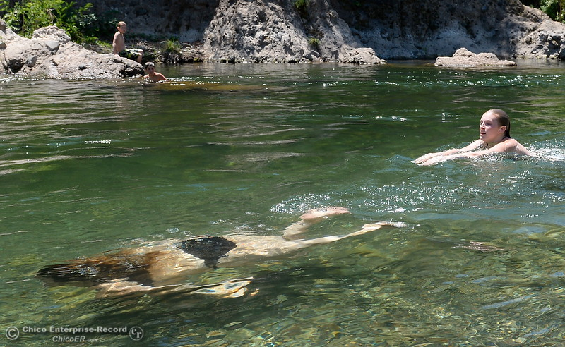 Swimmers enjoy the cool waters of Butte Creek as temps reach triple digits again today in Chico, Calif. Thurs. June 22, 2017.  (Bill Husa -- Enterprise-Record)