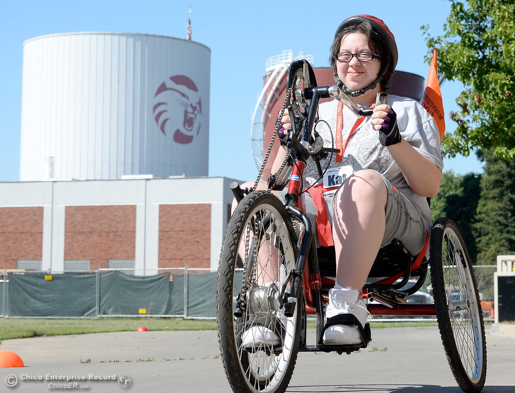 . Kat Kane smiles as she takes off for a ride on a hand cycle during the Ability First Camp for kids with disabilities at CSUC Tuesday June 20, 2017. (Bill Husa -- Enterprise-Record)