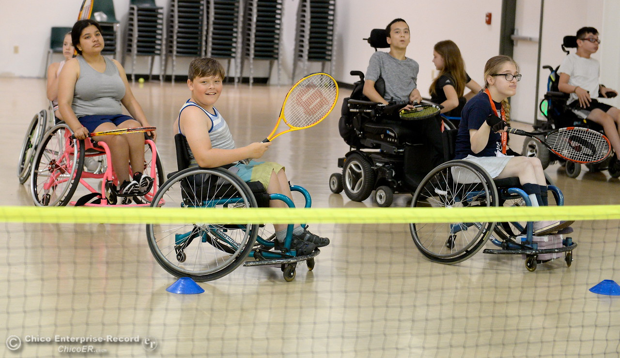 A group of campers get ready for a tennis lesson during the Ability First Camp for kids with disabilities at CSUC Tuesday June 20, 2017. (Bill Husa -- Enterprise-Record)