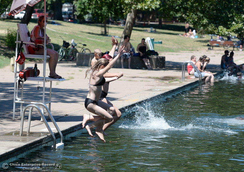 Hannah Campbell and Sierra Storni of Chico jump in togethr under the watchfull eye of a lifeguard as they cool off in Sycamore Pool at the One Mile Recreation Area in Bidwell Park Tuesday June 20, 2017. (Bill Husa -- Enterprise-Record)
