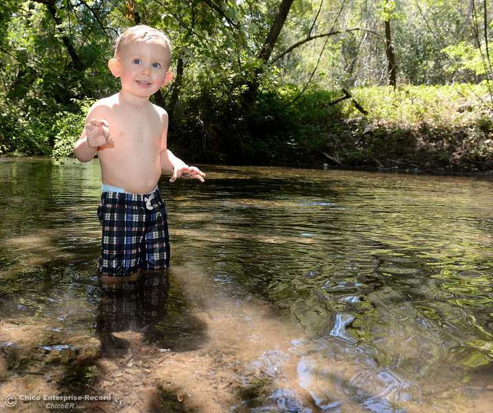 18-month-old Liam Hankins enjoys the cool water of Big Chico Creek as he spends time with Dad Corey Hankins and Mom Amanda Robertson in Lower Bidwell Park as temps reach triple digits today in Chico, Calif. Thurs. June 22, 2017.  (Bill Husa -- Enterprise-Record)