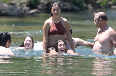 Angelina Kempton gets a ride from her sister Marissa Kempton as they cool off in Butte Creek during triple digits temperatures again today in Chico, Calif. Thurs. June 22, 2017.  (Bill Husa -- Enterprise-Record)