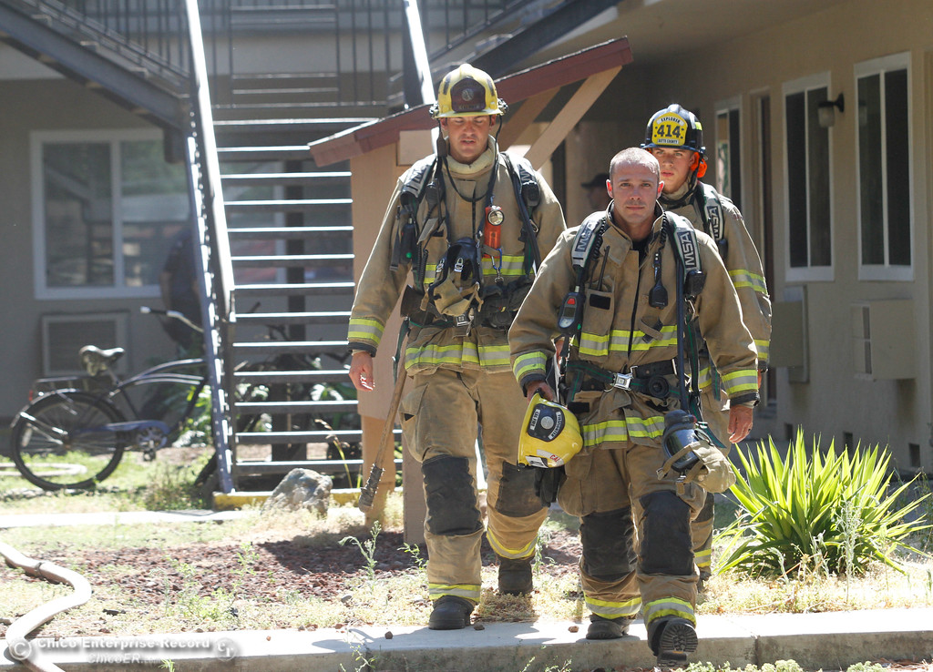 . Cal Fire firefighters John Perata, Lane Costa and Rick Manson after Chico Fire and Cal Fire  quickly put out an apartment building fire that started in the water heater closet on  Citrus Avenue Monday June 19, 2017 in Chico, California. (Emily Bertolino -- Enterprise-Record)