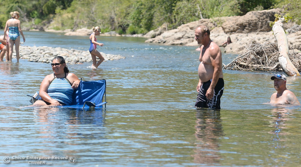 . Toni Franco of Durham sits in the water while cooling off in Butte Creek as temps reach triple digits again today in Chico, Calif. Thurs. June 22, 2017.  (Bill Husa -- Enterprise-Record)