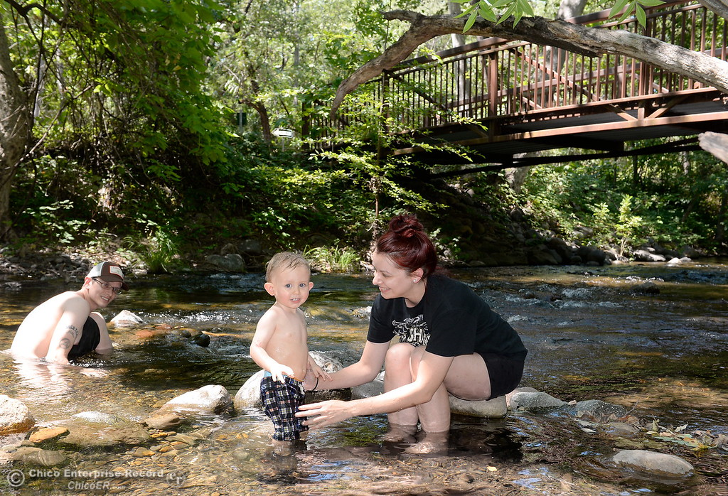 . 18-month-old Liam Hankins enjoys the cool water of Big Chico Creek as he spends time with Dad Corey Hankins and Mom Amanda Robertson in Lower Bidwell Park as temps reach triple digits today in Chico, Calif. Thurs. June 22, 2017.  (Bill Husa -- Enterprise-Record)