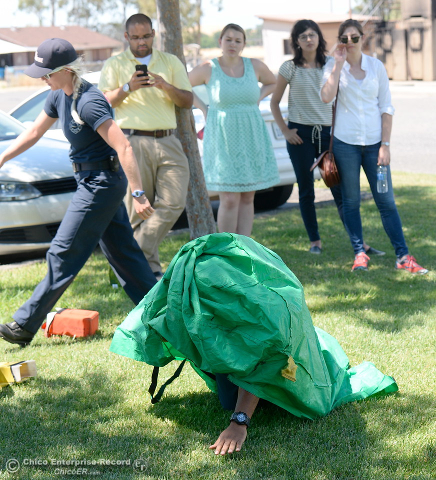 Representatives from CAL FIRE, PG&E, Butte County Sheriff's Dept. teach fire safety to a group of media representatives during a fire safetly training held at the Butte College Training facility Monday, June 19, 2017. (Bill Husa -- Enterprise-Record)