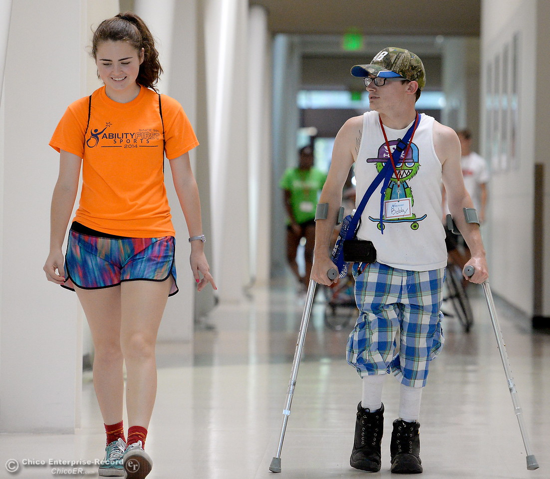 Volunteers Jessie Garrett left and Bobby McDaniel at right are seen during the Ability First Camp for kids with disabilities at CSUC Tuesday June 20, 2017. Bobby said he attended as a kid 5-years-ago and now is giving back by volunteering at the event. (Bill Husa -- Enterprise-Record)