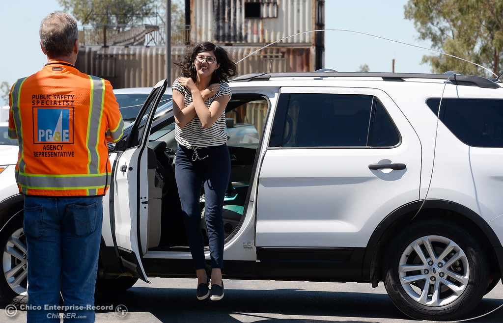 . Chico ER Reporter Dani Anguiano learns how to escape from a vehicle in contact with a live power line as representatives from CAL FIRE, PG&E, Butte County Sheriff\'s Dept. teach fire safety to a group of media representatives during a fire safetly training held at the Butte College Training facility Monday, June 19, 2017. (Bill Husa -- Enterprise-Record)