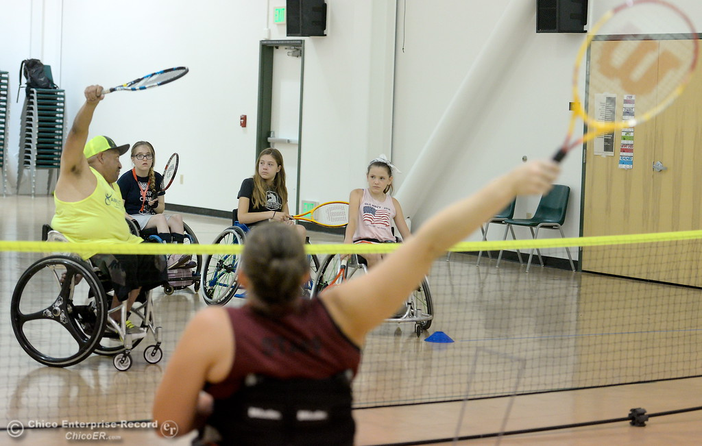 . Instructors Anthony Lara left and Elissa Robinson, (AKA Mouse) foreground teach tennis skills during the Ability First Camp for kids with disabilities at CSUC Tuesday June 20, 2017. (Bill Husa -- Enterprise-Record)