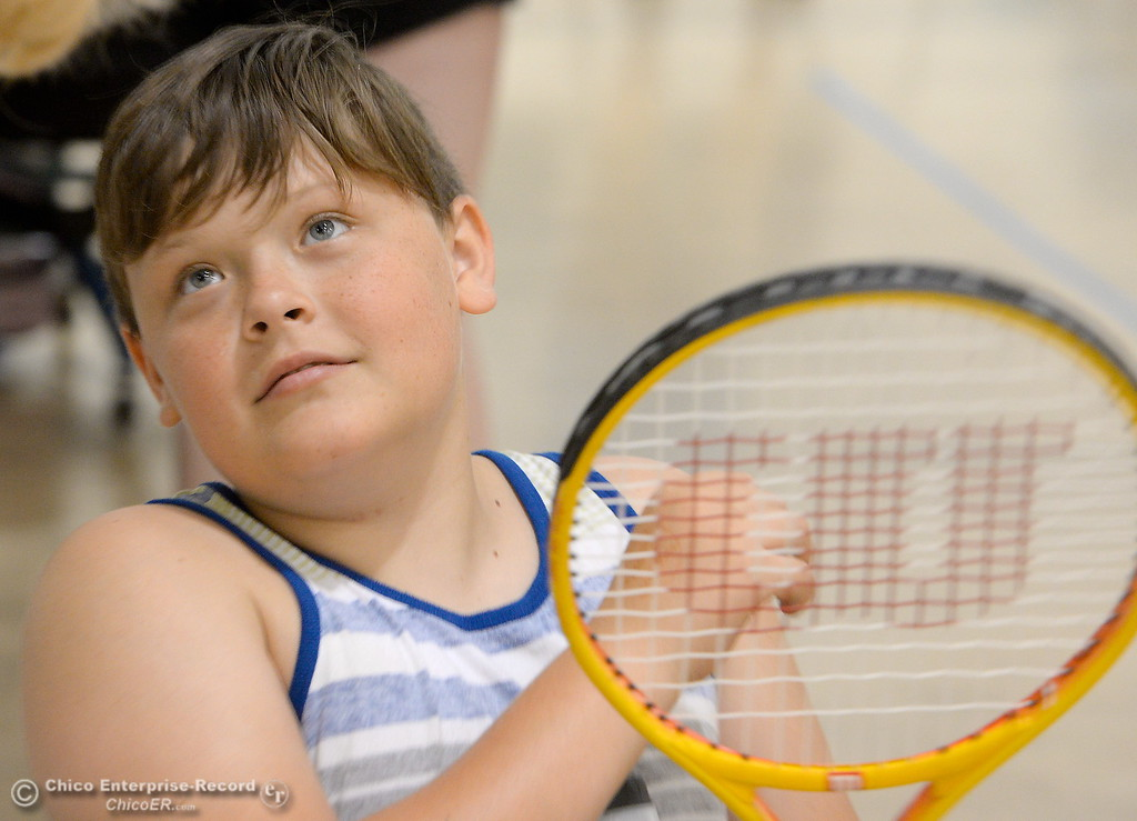 . 11-year-old Kanon Aiono of Sacramento gets ready to play some tennis during the Ability First Camp for kids with disabilities at CSUC Tuesday June 20, 2017. (Bill Husa -- Enterprise-Record)