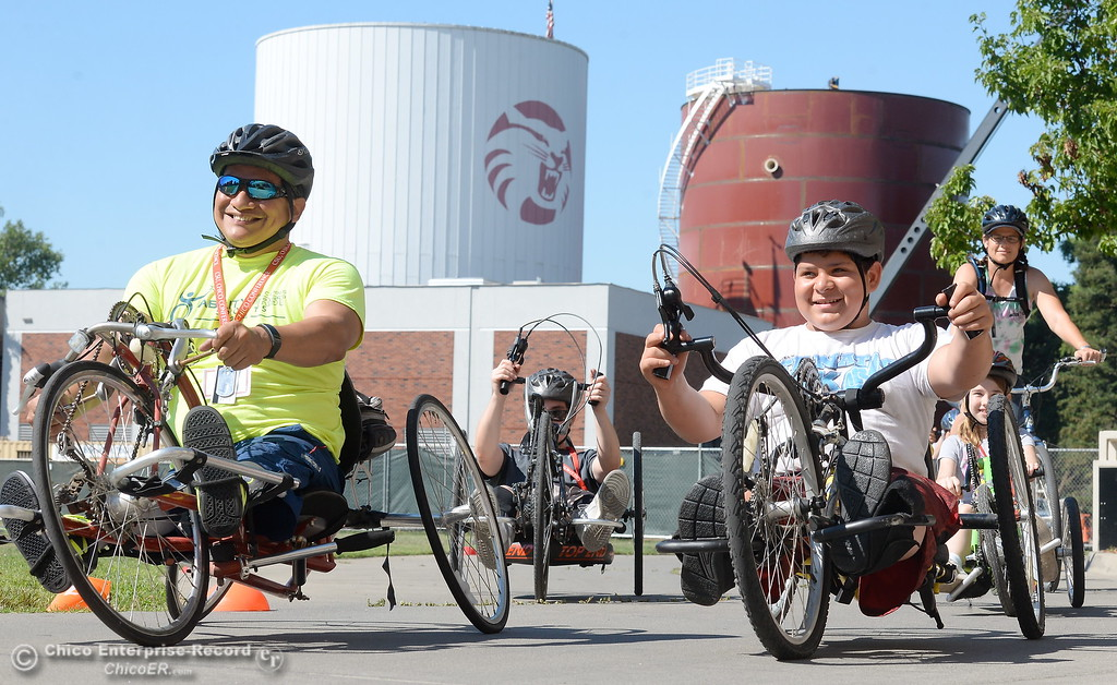 . Left to right, Romeo Capell, Isias Chavez and Shawn Vanaman take off on hand cycles during the Ability First Camp for kids with disabilities at CSUC Tuesday June 20, 2017. (Bill Husa -- Enterprise-Record)