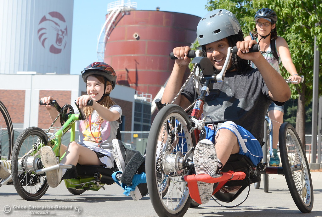 . At right, Trevor Ford of Chico smiles as he and others take off for a ride on hand cycles during the Ability First Camp for kids with disabilities at CSUC Tuesday June 20, 2017. (Bill Husa -- Enterprise-Record)