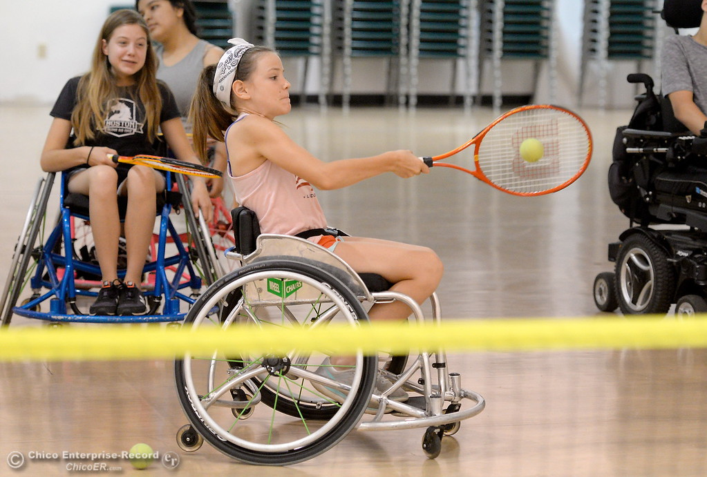 . Sisters Eliza and Emma Weaver play tennis during the Ability First Camp for kids with disabilities at CSUC Tuesday June 20, 2017. (Bill Husa -- Enterprise-Record)
