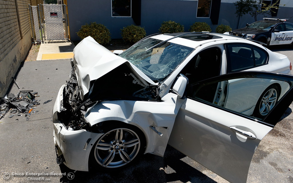 . A 72-year-old Chico man was transported by ambulance with major injuries after an apparent medical condition caused him to crash his 2013 BMW into a wall near the NS FIT building in Chico, Calif. Thurs. June 22, 2017.  (Bill Husa -- Enterprise-Record)