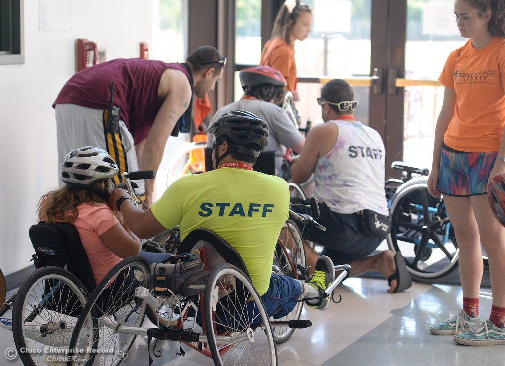 . Campers prepare for a hand cycle ride during the Ability First Camp for kids with disabilities at CSUC Tuesday June 20, 2017. (Bill Husa -- Enterprise-Record)