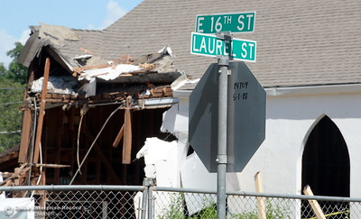 The Church is the only things still standing Monday afternoon as demolition is underway of the old Salvation Army building and church located on the corner of East 16th Street and Laurel St. in Chico, Calif. Mon. May 14, 2018.  (Bill Husa -- Enterprise-Record)