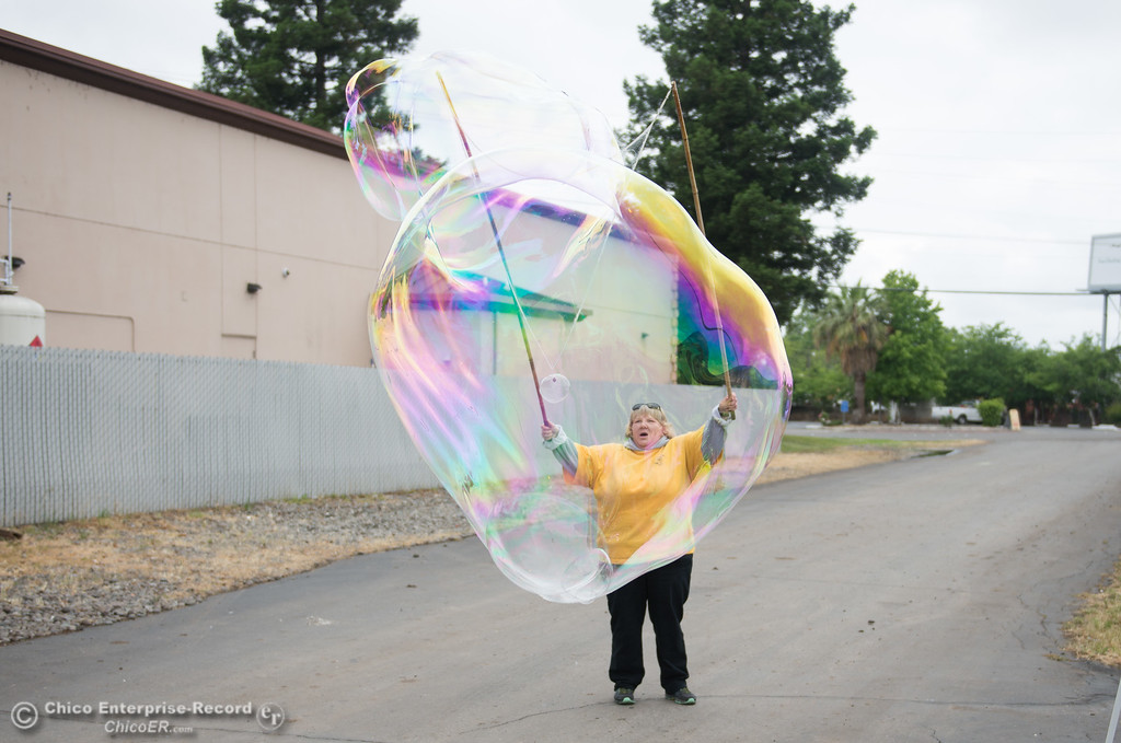 . Karen Boeller blows giant bubbles outside of the Silver Dollar Fair, May 26, 2018,  in Chico, California. (Carin Dorghalli -- Enterprise-Record)