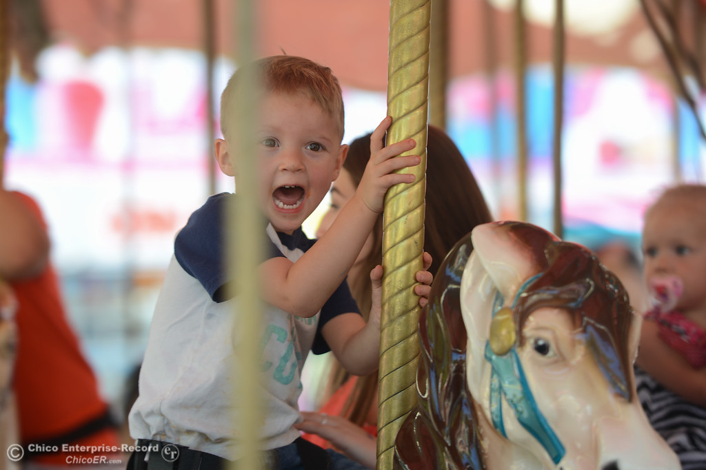 . Jacob Kelley rides around a carousel at the Glenn County Fair, May 17, 2018,  in Orland, California. (Carin Dorghalli -- Enterprise-Record)