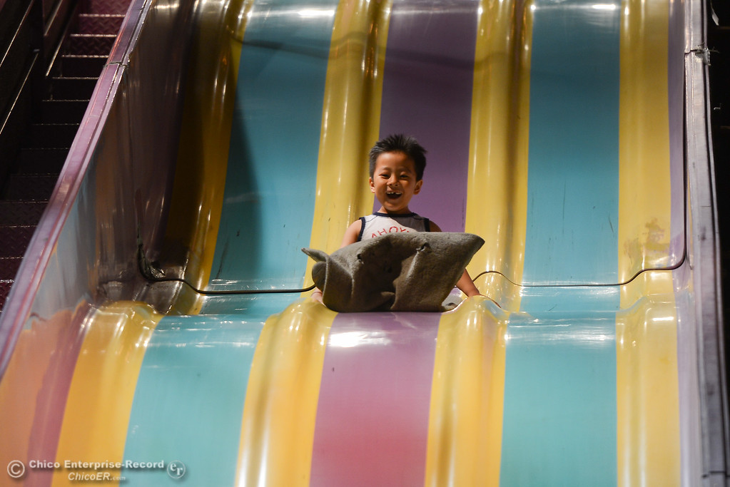 . Tyler Thao slides down a slide at the Silver Dollar Fair, May 24, 2018,  in Chico, California. (Carin Dorghalli -- Enterprise-Record)
