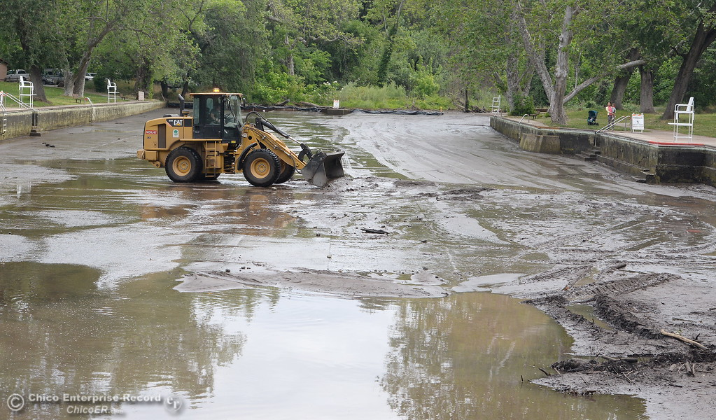 . City of Chico Senior Maintenance worker Kyle Phillips operates the loader while cleaning out Sycamore Pool at One Mile Recreation Area in Bidwell Park Wed. May 16, 2018.  (Bill Husa -- Enterprise-Record)