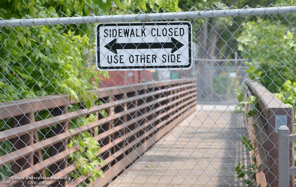 . The sidewalk is closed while Siskiyou Hall is fenced off as demolition is underway at Chico State University in Chico, Calif. Wednesday May 30, 2018. (Bill Husa -- Enterprise-Record)