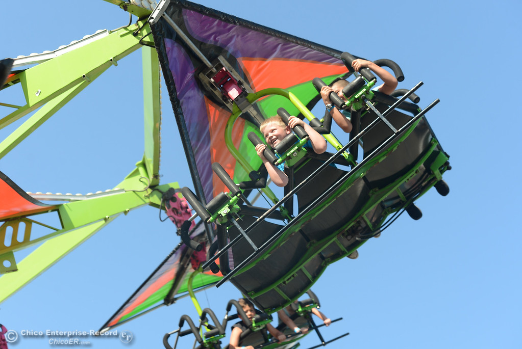 . Mason Ellgood and Leonardo Villicana fly through the air at the Glenn County Fair, May 17, 2018,  in Orland, California. (Carin Dorghalli -- Enterprise-Record)