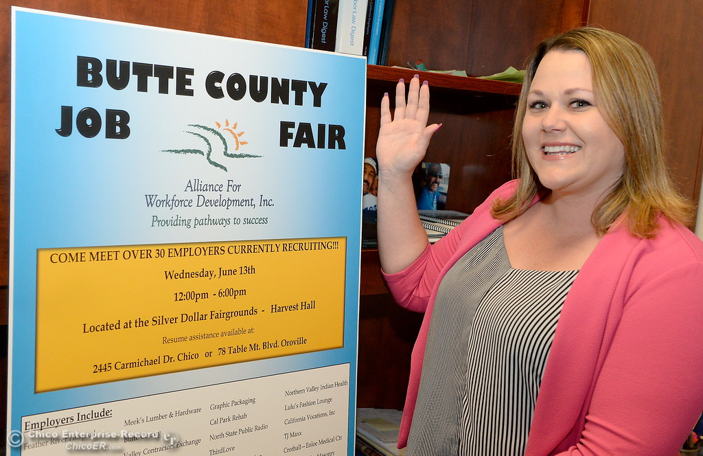 . Amy Velazquez smiles beside a poster advertising the June 13th job fair which will be held at the Silver Dollar Fairgrounds. Photo taken in Velazquez\'s office in Chico, Calif. Thurs. May 24, 2018. (Bill Husa -- Enterprise-Record)