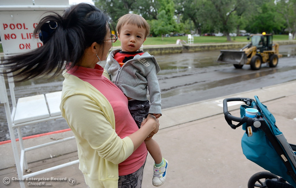 . 1-year-old Kyren Schaffer of Chico along with his Mom Yana Schaffer watch while City of Chico Senior Maintenance worker Kyle Phillips drives a loader to clean out Sycamore Pool at One Mile Recreation Area in Bidwell Park Wed. May 16, 2018.  (Bill Husa -- Enterprise-Record)
