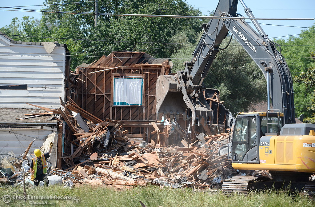 . A large excavatior makes quick work of the old buildings as demolition is underway of the old Salvation Army building and church located on the corner of East 16th Street and Laurel St. in Chico, Calif. Mon. May 14, 2018.  (Bill Husa -- Enterprise-Record)