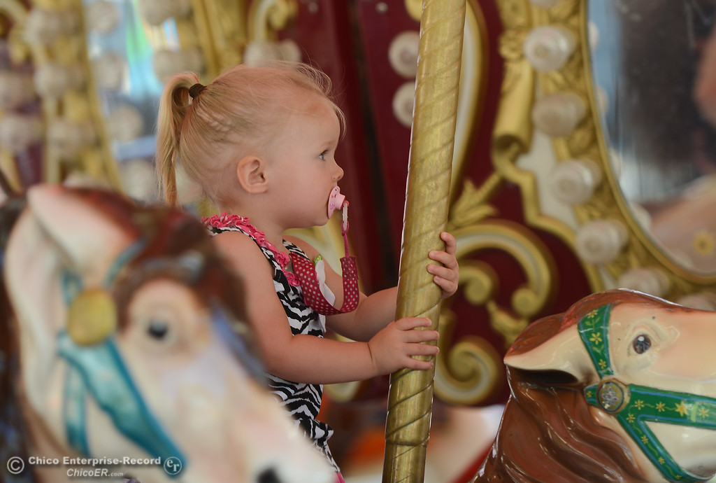 . Madison Kelley rides around a carousel at the Glenn County Fair, May 17, 2018,  in Orland, California. (Carin Dorghalli -- Enterprise-Record)