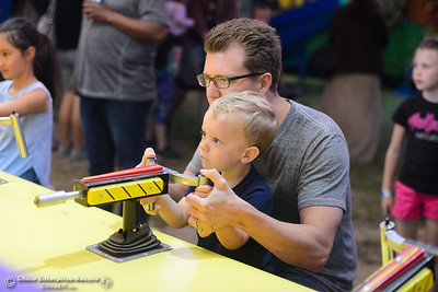 Steve and Graham Saner play carnival games at the Silver Dollar Fair, May 24, 2018,  in Chico, California. (Carin Dorghalli -- Enterprise-Record)